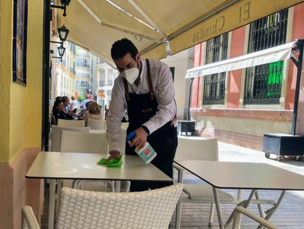 waiter disinfecting of high-contact surfaces malaga tours